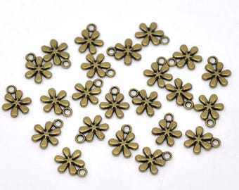 10 charms in antiqued bronze flower shape