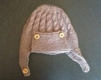 Cosy Aviator hat with ear flaps for a baby boy.