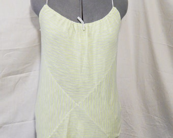 Bright yellow and white striped tank with asymmetrical hem and draw string neck. Made from 100% upcycled materials