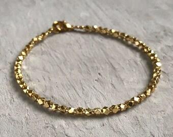 24k gold hill tribe beaded bracelet