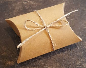Small cardboard gift box with string bow