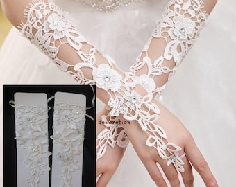 Light ivory beaded wedding gloves / bridal lace gloves / floral appliques is for sale. Sold By pair