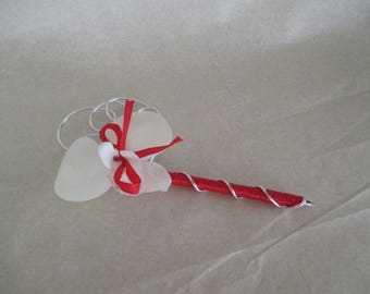 Red and white wedding guest book pen
