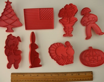 Set of 8 vintage red plastic COOKIE CUTTERS with handles - flag, turkey, Christmas, Halloween