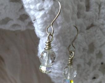 Sterling silver earrings and Swarovski  crystal. Earrings made of sterling silver and extra faceted Swarovski crystal balls.