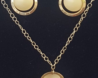 Gold toned necklace and earring set