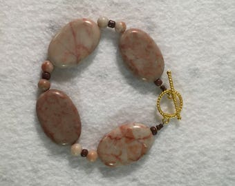 Large handmade flat stone and glass bead bracelet with toggle clasp