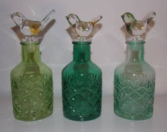 3 decorative bottles with corks bird stained glass