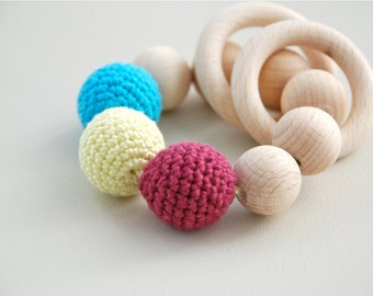 Teething toy with crochet wooden beads and 2 wooden rings. Berry, yellow, blue wooden beads rattle.