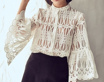 La chic Parisienne Collection white sheer designed lace shirt top with fan sleeves