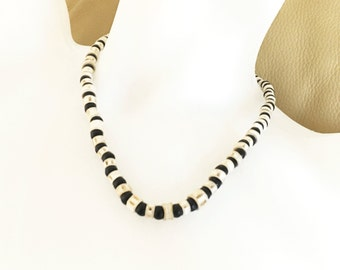 African black and white beaded necklace - Fish Vertebrae beads from Zambia with black beads make this cool necklace special