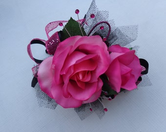 2 Piece wrist corsage and boutonniere in hot pink roses and black trim