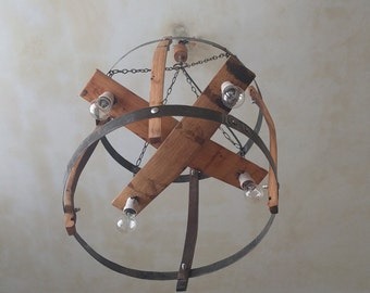 Rustic chandelier handmade from wine barrel staves and hoops.