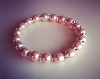 Bracelet perles rose poudre et petites fleurs argentées