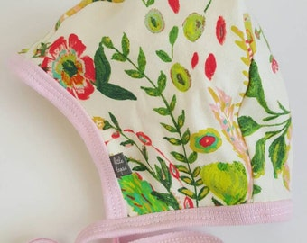 flower pilot hat by Little Lapsi. Baby hat with ties. hearing aid hat.