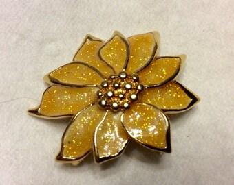 Vintage 1970's yellow glitter enamel poinsettia brooch pin.