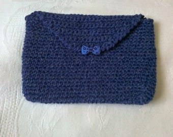 small pocket lined and closed with a button hook