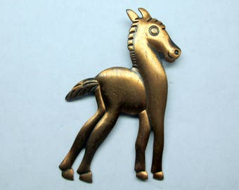 vintage copper pin / brooch of horse , whimsical comic style , mid century modern .