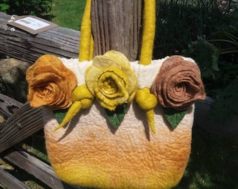 Felt handbag with matching decorative hand made felt roses. Lined with cotton fabric and finished with coiled handles.