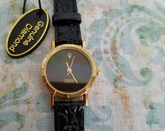 Genuine diamond vintage watch, real black leather band, gold tone, round face.