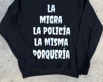La Migra La Policia Sweater