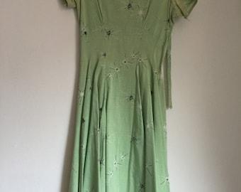 1950s chartreuse green starburst swing dress