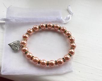 Peach pearl bracelet