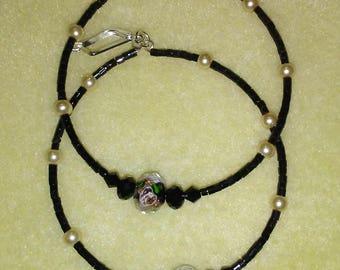 Beaded black hoop earrings