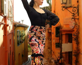 The Rosa.   Flamenco, Jersey skirt with a black ruffle flower. Very convenient because its spandex fabric. S/M T T L