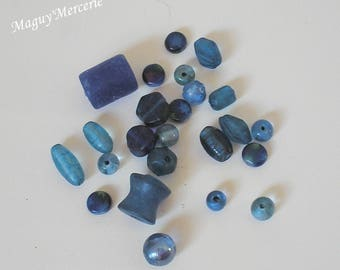 Assortment of 24 glass beads different shapes and sizes blue