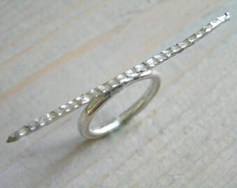 Long sterling silver bar ring.
