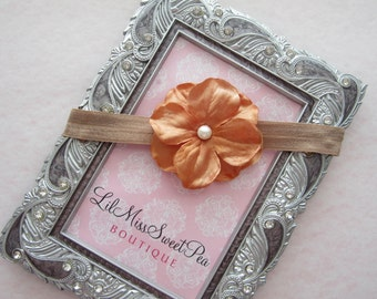 Copper colored flower on a dark tan headband, perfect for fall for all ages, for newborn photo shoots to adults