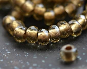 Fools Gold - Premium Czech Glass Beads, Transparent Smoky Quartz, Metallic Gold, Rollers 6x9mm - Pc 10