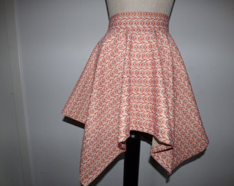 Wheeled skirt with four-pointed hem.