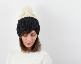 Chunky Knit Pom-Pom Hat, Two-Tone, Wool Blend | THE BERLIN in Charcoal + Snow