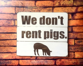 "Lonesome Dove ""We Don't Rent Pigs"" Sign"