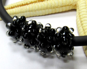SMAUGGS handmade lampwork bead  (1pc, 10mmx5mm), glass, black, transparent dots, hole 4 or 5mm