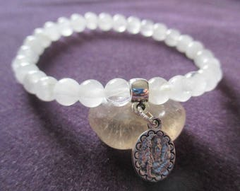 Bracelet rock crystal and Holy medal.