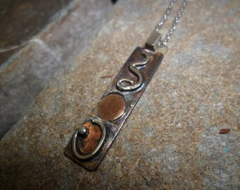 Pendant sterling silver oxidized with fusion of copper and silver