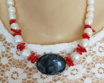 White pearl necklace and coral necklace