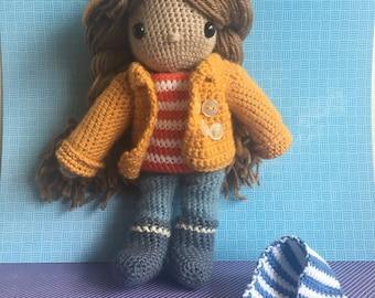 Cute crochet doll with rain clothes