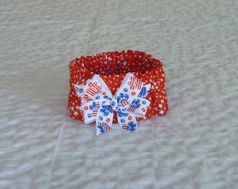 "Dog Ruffle Collar, Pet Bandana - Starburst on Red Patriotic Dog Scrunchie Collar with patriotic paws bow - Size S: 12"" to 14"" neck"