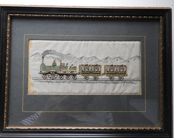 antique miniature embroidery of green train on silk, framed,glazed