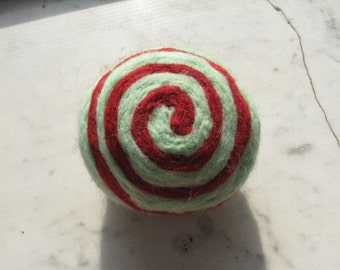 One multi-colored felted pin-cushion, Red and Mint Green