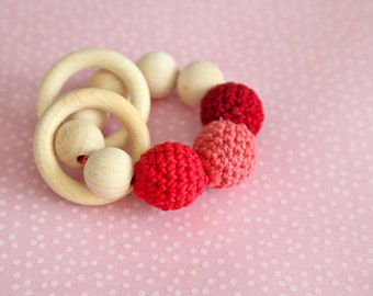 Teething toy with crochet red, coral, burgundy wooden beads and 2 wooden rings. Wooden rattle. Gift for baby.