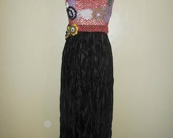 crochet top with a black long skirt