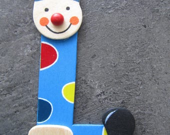 "Painted wood - representing the letter ""L"" in the form of a clown"