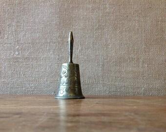 vintage solid brass dinner bell with engraved leaf design, home decor