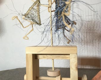 Mother, automaton in wood and lace