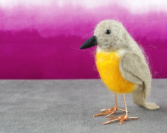 Small needle felted bird ornament.